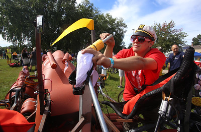 3rd annual Kinetic Sculpture Race entries enter the Merrimack River at the boat ramp and exit at Rynne Beach. Nick Anastasia of Somerville partially lowers the Lobster Roll's flotation devices prior to the water event. (SUN/Julia Malakie)