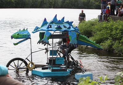 3rd annual Kinetic Sculpture Race entries enter the Merrimack River at the boat ramp and exit at Rynne Beach. Oh! Snap! launches. (SUN/Julia Malakie)