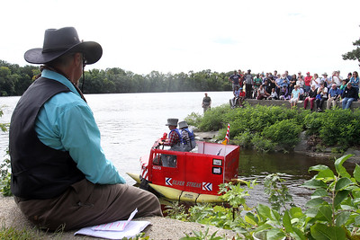 3rd annual Kinetic Sculpture Race entries enter the Merrimack River at the boat ramp and exit at Rynne Beach. Silver Streak gets underway on the water. (SUN/Julia Malakie)