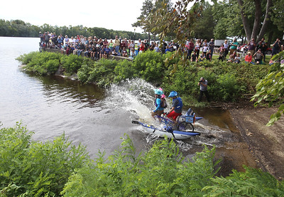 3rd annual Kinetic Sculpture Race entries enter the Merrimack River at the boat ramp and exit at Rynne Beach. Fish Heads launches. (SUN/Julia Malakie)