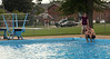 Steve Fraley poolside while his son takes a dip.