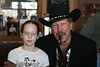 Kinky Friedman and a young fan<br /> It doesn't show well, but she's quite excited. Grace had been looking forward to this event for a while.