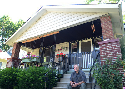 Erica Benson-ebenson@shawmedia.com Berwyn resident Thomas Sturm sits outside his kit home Saturday August 3 2013. The mail order house was built in 1914.