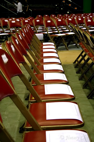 All chairs are laid out with a survey form.