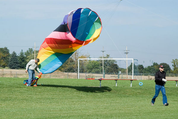 """<font size=""""3"""">You get a much better idea of the size of these kites when you have a person for comparison.</font>"""