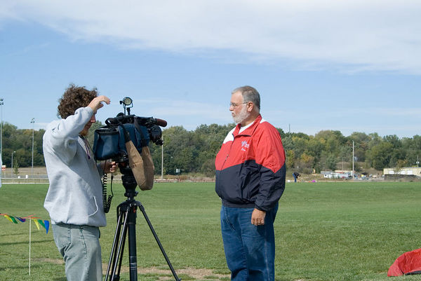 """<font size=""""3"""">A TV reporter interviews Don Murphy, president of the group.  Don is also regional director of the <a href=""""http://www.aka.kite.org"""" TARGET=""""_blank"""">American Kitefliers Association</a>.</font>"""