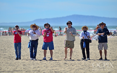 Group of kite flyers in Huntington Beach California