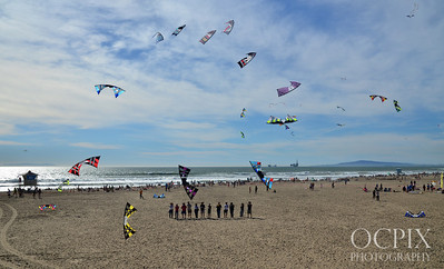 Kite flyers perform for the crowds at Huntington Beach