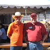 Southwest District Governor, Bobby Davis, is welcomed to Kid's Day at the Fair by OakCraft founder, LeRoy Zachek.