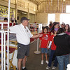 Bob Kay, of the Capitol Gateway Kiwanis Club, mans the gate at the Fair's Petting Zoo, a popular place for the children to visit.