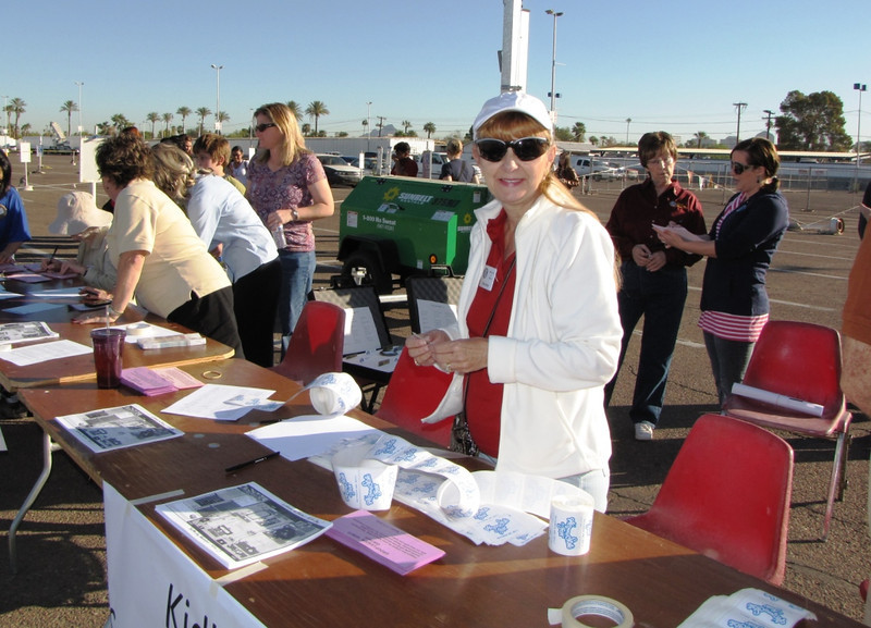 The morning starts early with dozens of Kiwanians preparing for registration, traffic control, and a dozen other details to make the day run successfully.  Phoenix Club member, Pam Spitler, prepares badges for the high school volunteers.