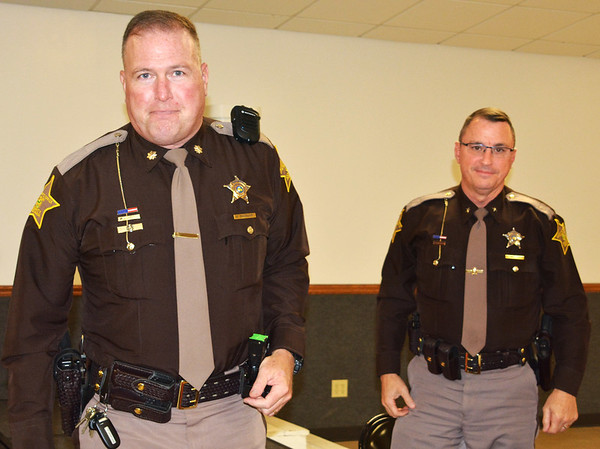Debbie Blank | The Herald-Tribune<br /> Ripley County Sheriff's Office Chief Deputy Kurt Enneking (left) and Sheriff Jeff Cumberworth relaxed after a work day in Versailles.
