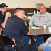 Debbie Blank | The Herald-Tribune<br /> Batesville Fire and Rescue Department Chief Todd Schutte (center) brought a large crew.