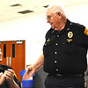Debbie Blank | The Herald-Tribune<br /> Oldenburg Marshal Bill Dramann (standing) was applauded by Deputy Eric Moenter and the rest of the room for his 49-year law enforcement career, the longest tenure of anyone there.