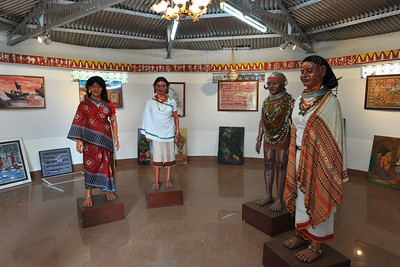 Model of tribals and their paintings in Tribal Art Gallery, Orissa seen during a visit to the tribal village recreated in Bhubaneshwar, Orissa.