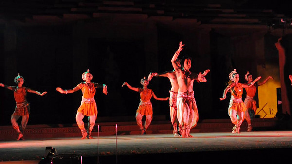 Short video clip of Odissi Dance Group, Sutra Dance Theatre from Kuala Lumpur, Malaysia. The Konark Dance & Music Festival held from February, 19th to 23rd, 2010 was organized by Konark Natya Mandap.  The objectives of the Konark Natya Mandap are to preserve, promote, and project the rich cultural heritage of Orissa and to infuse cultural awareness in the minds of all. Started with painstaking efforts of Guru Gangadhar Pradhan, an internationally renowned Odissi dance teacher. 2010 was the silver jubilee year of the festival. For more details see  http://www.konarknatyamandap.org/    The festival takes place in an open-air auditorium and enlivens the spirit of the sculptures of Konark temple which is just a short distance away. The festival brings in the spirit of merry to all the onlookers. The music reverberates and combined with the sounds of the ankle bells of the dancers enthralls the audiences. The elegant steps and expressions of the dancers makes the event so captivating that no one can ever forget it.