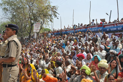 People wave out and feel blessed if the Naga sadhus look, wave, or throw a flower at them. The sadhus slowly head to Har Ki Pauri for the holy dip. Pilgrims line on either side of the road for seeking blessings and para military forces provide security cover.  Kumbh Mela is the biggest religious gatherings on the planet which takes places on the banks of the river Ganga. The number of pilgrims this year is expected to exceed around five million since the first day Jan 14 till the time it concludes on April 28, 2010. Haridwar, Uttarakhand. North India.