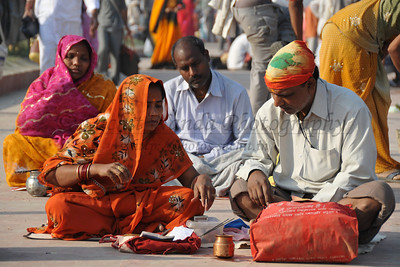 Hindu prayers and poojas being conducted on the river bank of Ganga on the occasion of Kumbh Mela.  Kumbh Mela is the biggest religious gatherings on the planet which takes places on the banks of the river Ganga. The number of pilgrims this year is expected to exceed around five million since the first day Jan 14 till the time it concludes on April 28, 2010. The auspicious days of the shahi snan or royal baths usually draw hundreds of thousands of devotees to the Har Ki Paudi and other banks of the river. Uttarakhand. North India. The occasion draws pilgrims from around the world and severly overloads the infrastructure so most of the city is shut down for any vehicles other than security or emergency services so a sea of humanity walks through the city to get to the bathing ghats.