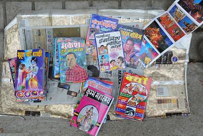 Books and magazines on sale on the street shop.  Kumbh Mela is the biggest religious gatherings on the planet which takes places on the banks of the river Ganga. The number of pilgrims this year is expected to exceed around five million since the first day Jan 14 till the time it concludes on April 28, 2010. Haridwar, Uttarakhand. North India.