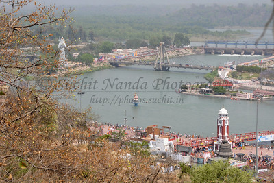 Ariel view of Har Ki Paudi, Haridwar from road to the hill top Mansa Devi Temple.  Kumbh Mela is the biggest religious gatherings on the planet which takes places on the banks of the river Ganga. The number of pilgrims this year is expected to exceed around five million since the first day Jan 14 till the time it concludes on April 28, 2010. Haridwar, Uttarakhand. North India.