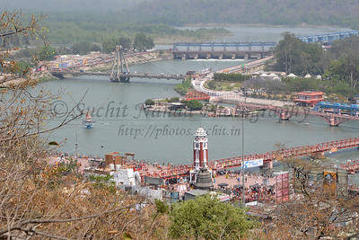 Ariel view of Har Ki Paudi, Haridwar taken from road leading to Mansa Devi Temple.  Kumbh Mela is the biggest religious gatherings on the planet which takes places on the banks of the river Ganga. The number of pilgrims this year is expected to exceed around five million since the first day Jan 14 till the time it concludes on April 28, 2010. Haridwar, Uttarakhand. North India.