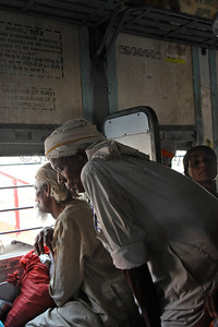 View of the inside of a packed train while had people inside, outside (on top and sides) and in between carriages!  Due to the Shahi Snan, getting into Haridwar for the Kumbh Mela was a serious challenge as hundreds of thousands of pilgrims poured in. Took an Air India flight from Delhi to Jolly Grant, Dehradun and with a mix of Tempo, bus, rickshaw, train, bike-ride and walk, finally got into the city.  Kumbh Mela is the biggest religious gatherings on the planet which takes places on the banks of the river Ganga. The number of pilgrims this year is expected to exceed around five million since the first day Jan 14 till the time it concludes on April 28, 2010. The auspicious days of the shahi snan or royal baths usually draw hundreds of thousands of devotees to the Har Ki Paudi and other banks of the river. Uttarakhand. North India.