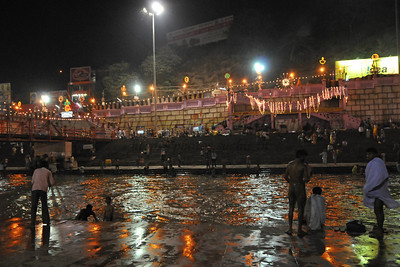 Evening before the biggest Shahi Snan on April 14, was crowded but the lull before the storm.  Hundreds of thousands of pilgrims poured into Haridware for the Kumbh Mela. Kumbh Mela is the biggest religious gatherings on the planet which takes places on the banks of the river Ganga. The number of pilgrims this year is expected to exceed around five million since the first day Jan 14 till the time it concludes on April 28, 2010. The auspicious days of the shahi snan or royal baths usually draw hundreds of thousands of devotees to the Har Ki Paudi and other banks of the river. Uttarakhand. North India.