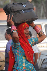 Colourful women from Rajasthan leaving Haridwar.  Kumbh Mela is the biggest religious gatherings on the planet which takes places on the banks of the river Ganga. The number of pilgrims this year is expected to exceed around five million since the first day Jan 14 till the time it concludes on April 28, 2010. Haridwar, Uttarakhand. North India.