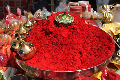 Red is considered an auspicious colour and red powder applied to the parted hairline is a sign of marriage. Lal tikka (red dot) is also a form of blessing, so red power and power of other colours is widely available on the street shops.  Kumbh Mela is the biggest religious gatherings on the planet which takes places on the banks of the river Ganga. The number of pilgrims this year is expected to exceed around five million since the first day Jan 14 till the time it concludes on April 28, 2010. The auspicious days of the shahi snan or royal baths usually draw hundreds of thousands of devotees to the Har Ki Paudi and other banks of the river. Uttarakhand. North India. The occasion draws pilgrims from around the world and severly overloads the infrastructure so most of the city is shut down for any vehicles other than security or emergency services so a sea of humanity walks through the city to get to the bathing ghats.