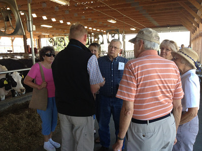 Veterinarian James Holt, of Brandywine Veterinary Services, discusses the cows' feed and milk production with visitors at Kurtland Farms' open house Saturday.