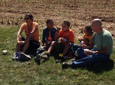 A family enjoys free ice cream at Kurtland Farms' open house Saturday.
