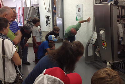 Visitors get a close look at the milking robots in action at Kurtland Farms' open house Saturday.