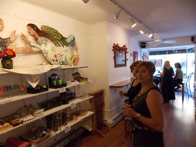 Pam Kelchner, right, and Tina Ulaner view Maureen Yoder's art at Vynecrest Winery's shop in Kutztown for Artists' Harvest Oct. 4. Patriot photo by Lisa Mitchell