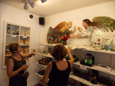 Pam Kelchner, left, and Tina Ulaner view Maureen Yoder's art at Vynecrest Winery's shop in Kutztown for Artists' Harvest Oct. 4. Patriot photo by Lisa Mitchell
