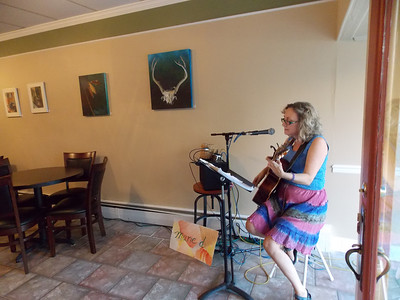 Marie De Fillips displays her art and performs at Wholesome Foods in Kutztown for Artists' Harvest Oct. 4. Patriot photo by Lisa Mitchell