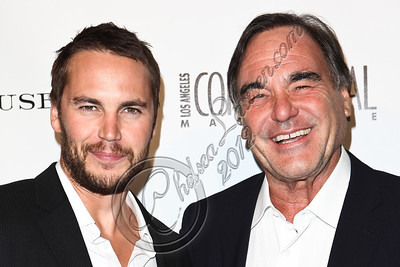 WEST HOLLYWOOD, CA - JUNE 14:  Actor Taylor Kitsch (L) and director Oliver Stone (R) arrive at Los Angeles Confidential Magazine's summer issue release party at Palihouse Holloway on June 14, 2012 in West Hollywood, California.  (Photo by Chelsea Lauren/WireImage)