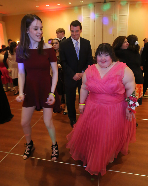 . LABBB Collaborative\'s Prom at the Boston Marriott Burlington. Caitlin Martinage, 16, of Burlington, left, and Emma Granienelles, 21, of Framingham. (SUN/Julia Malakie)