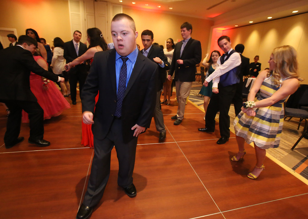 . LABBB Collaborative\'s Prom at the Boston Marriott Burlington. Joey Goulet, 20, of Acton, center. At right are Cole Fitzpatrick, 22, second from right, and Myriah Tucker, both of South Hamilton. (SUN/Julia Malakie)