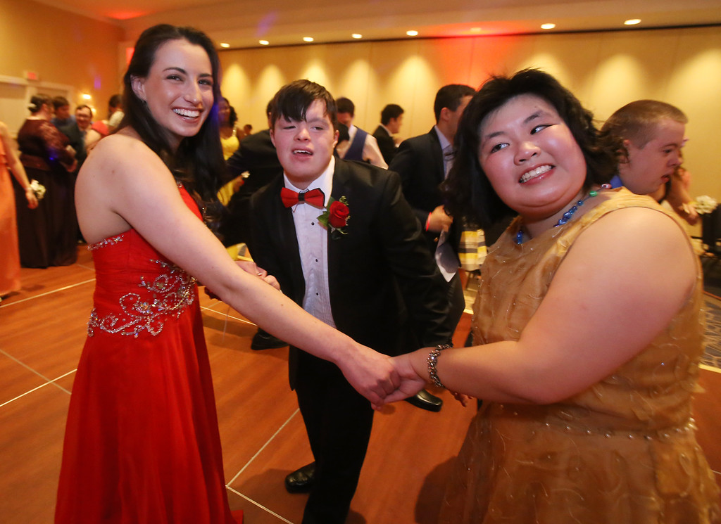 . LABBB Collaborative\'s Prom at the Boston Marriott Burlington. Jamie Barth, 18, of Littleton, and Tucker Collins, 18, of Shrewsbury, who are friends from Miracle League where Barth volunteers, and Miranda Chea, 16, of Belmont. (SUN/Julia Malakie)