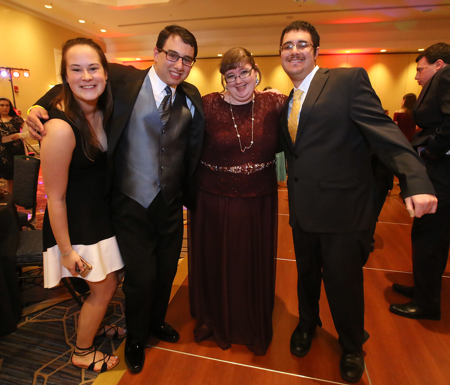 . LABBB Collaborative\'s Prom at the Boston Marriott Burlington. From left, Lily Meyers, 20, of Wellesley, Jacob Myers, 20, of Bedford, Erin MacArthur, 22, of Winchester, and Josh Beshansky, 21, of Groton. (SUN/Julia Malakie)