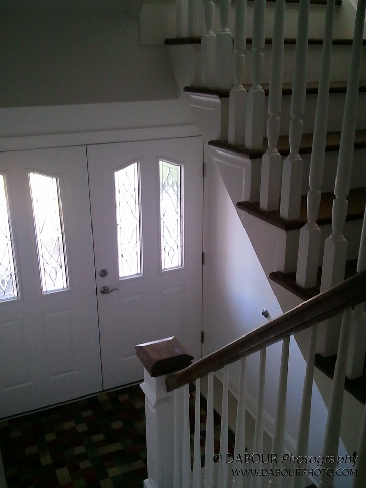 Staircase looking at front door