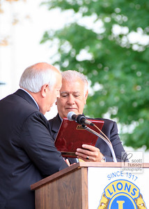 BOB CORLEW PRESENTS MAYOR GATSAS WITH THE 2016 PEACE POSTER PLAQUE