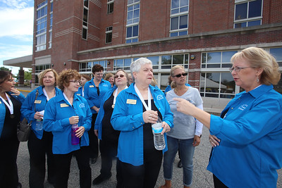 Lowell General Hospital celebrates 20th anniversary of its Cancer Center. New England Voices in Harmony, a women's barbershop chorus, including Diane Fagerstrom of Gardner, center, and Liane Iannuzzo of Nashua, right, arrive to perform. They volunteered to perform after one of their members accompanied a friend to the Cancer Center. (SUN/Julia Malakie)