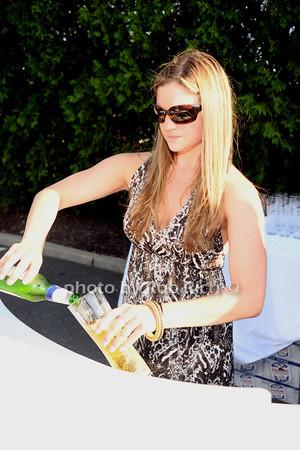Dana Brockway pouring Peroni photo  by Rob Rich © 2012 robwayne1@aol.com 516-676-3939