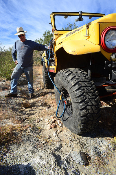 not the first and not the last tire losing air - not a flat, but tiny cactus punctures can cause slow leaks