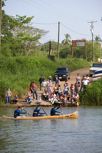 "Fans for the La Ruta Maya River Challenge wait at ""Baking Pot Ferry"" on the Belize Riverl, Cayo, Belize."