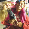 """Debbie Wachter/NEWS<br /> Too much sugar, or too much caffeine? Adrienne Gierlach, 7, rides piggyback, lopsided, on the shoulders of her dad, Kevin """"Cuzzie"""" Gierlach at the Lawrence County Fair. The Gierlach family is from Neshannock Township and his host to Haunted Summitview Drive every Halloween."""