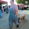 Debbie Wachter/NEWS<br /> George Colpetzer, 19, of Greenville, transports whole mlk in traditional milk cans from the milking parlor at the fair.
