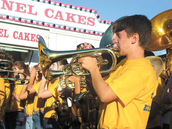 Debbie Wachter/NEWS<br /> The Wilmington High School marching  band shows a lot of brass at Wednesday's performance at the fair.