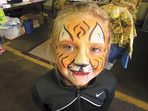 Debbie Wachter/NEWS<br /> Face-painting is one of the many attractions for kids at the fair. Alexis Hufnagel, 6, of New Castle, is a tiger.